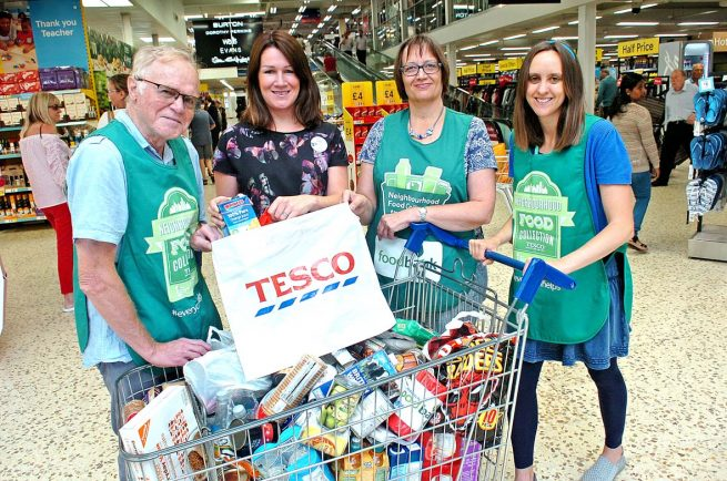 Residents Replenish Stockrooms Of The Towns Food Bank The